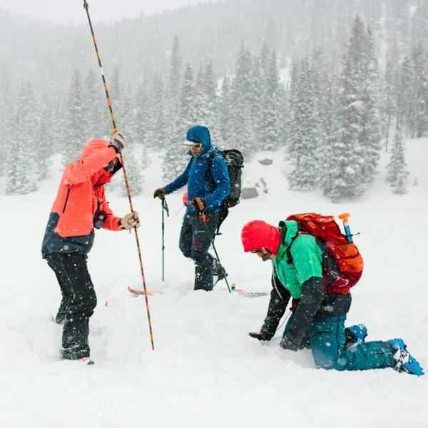 Avalanche Level 1 students practice probing during a rescue scenario in Rocky Mountain National Park, Colorado.