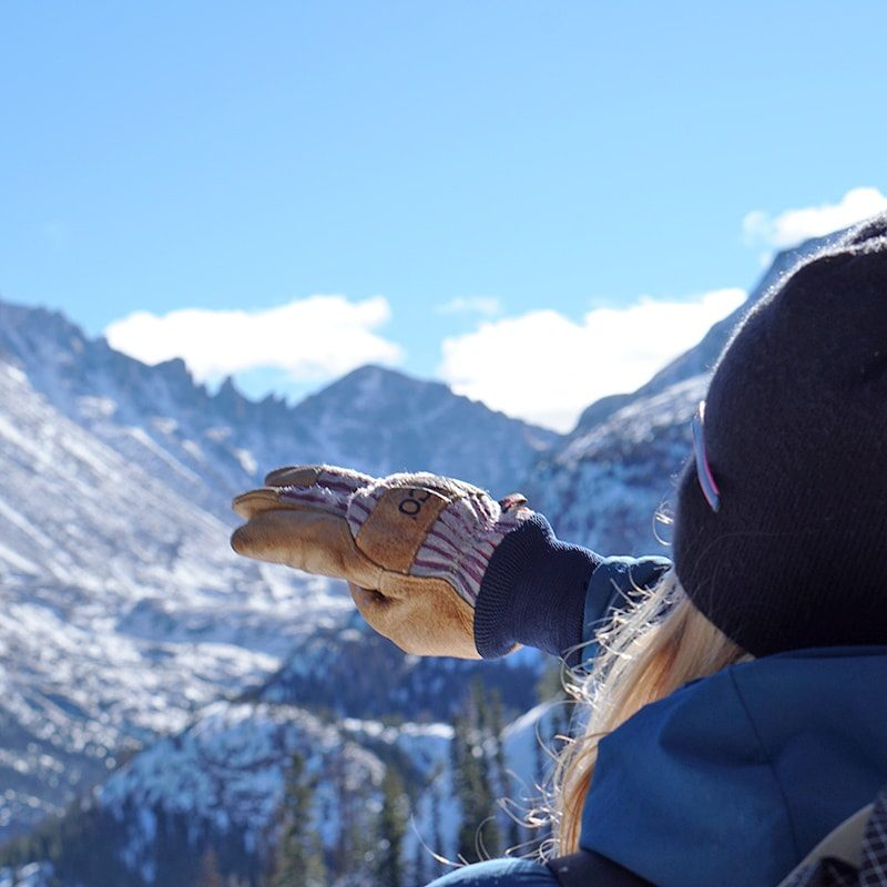 An AIARE 1 course leader points out avalanche terrain features during a level 1 avalanche course in Colorado's Rocky Mountain National Park.
