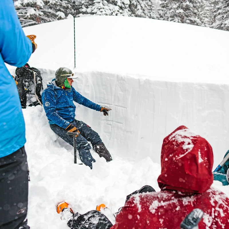 Colorado Mountain School AIARE Instructor, Jake Gaventa, teaches snow science to a group of backcountry travelers on a Level 1 Avalanche Course near Denver, Colorado.