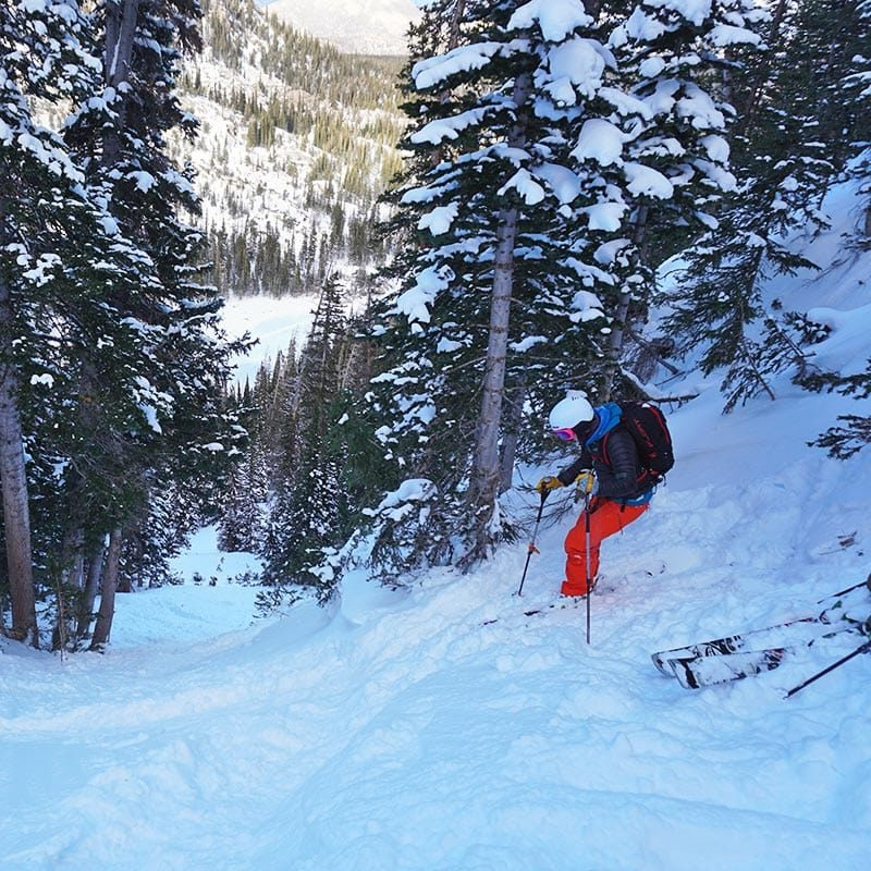 A backcountry skier drops in on a beginner skiing course in Colorado.