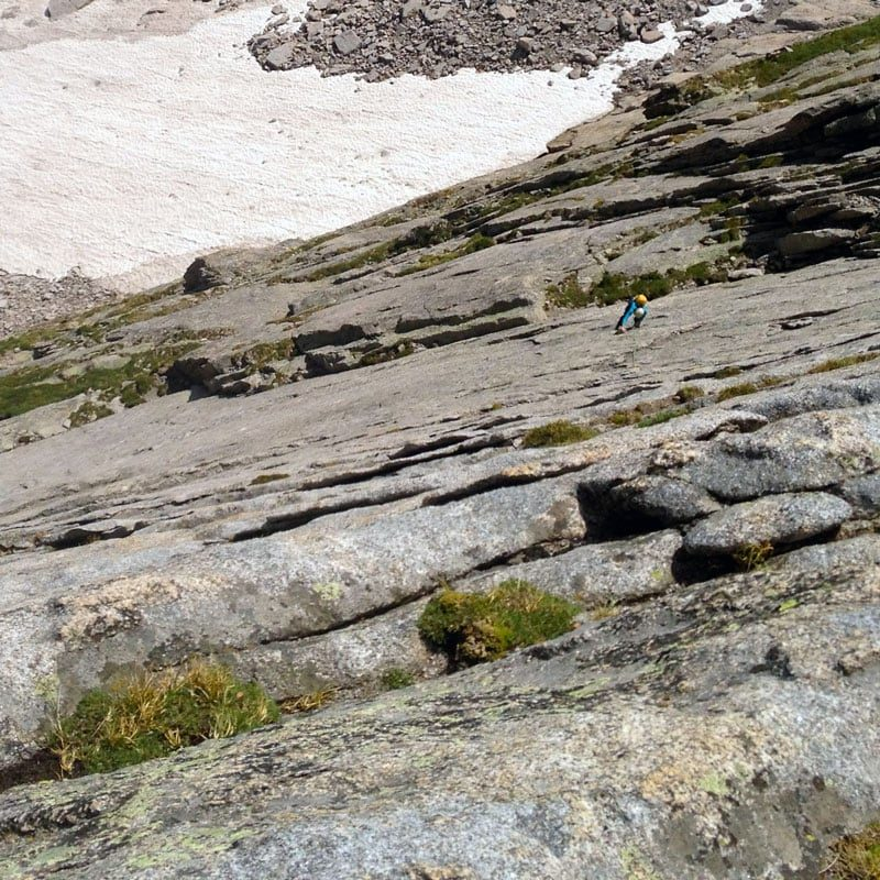 A rock climber works her way up The Spearhead in Rocky Mountain National Park.