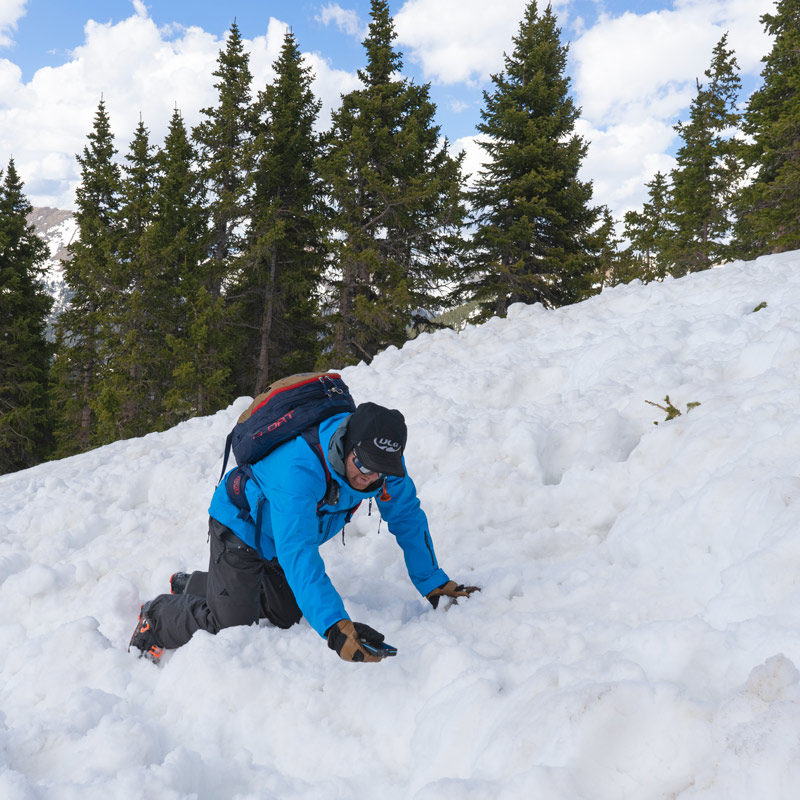 A student on an AIARE 1 Hut Course performs a beacon search in an avalanche debris field in Colorado.