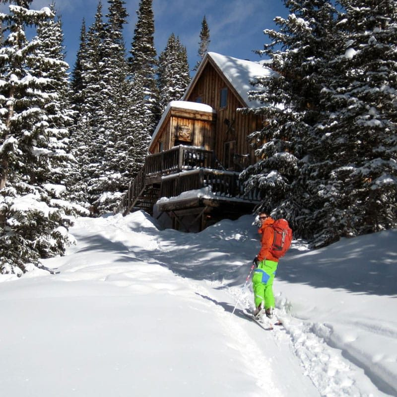 A student skis toward a hut on an AIARE 1 hut trip in Colorado.