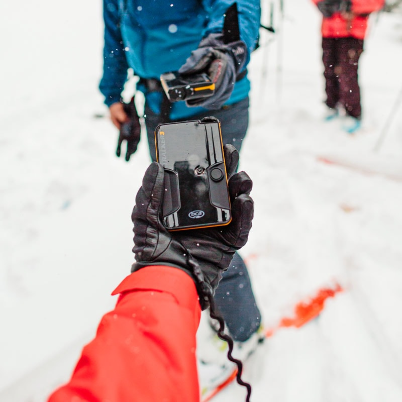 Students on an AIARE 1 course do a beacon check before leaving their hut for a backcountry ski tour. Colorado Mountain School teaches these classes throughout Colorado.