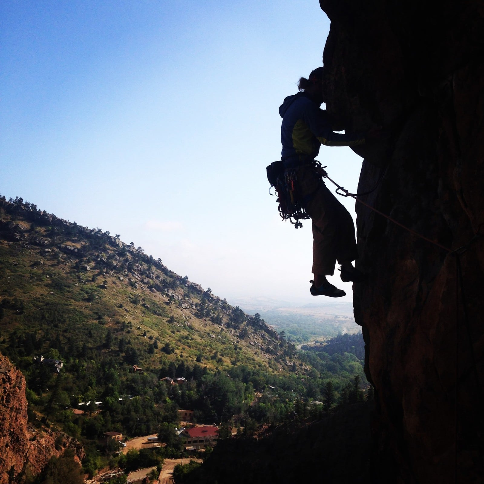 Participant on a rock climbing course near Boulder, Colorado - making their way up the Bastille in Eldorado Canyon.