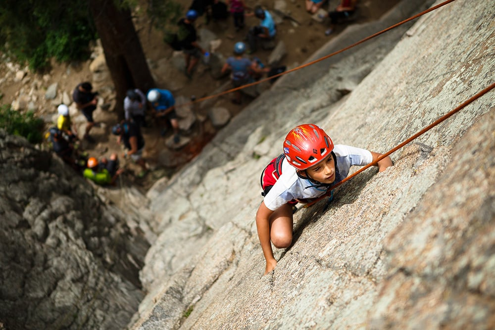 Young child rock climbing for the first time near Estes Park, Colorado
