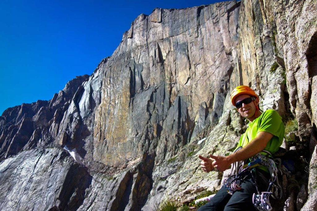 Colorado Mountain School guide Rainbow Weinstock is ready to climb the Casual Route on the Diamond in Rocky Mountain National Park