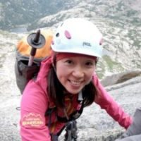 Colorado Mountain School Guide, Norie Kizaki, tops out on a mountaineering route in Rocky Mountain National Park.