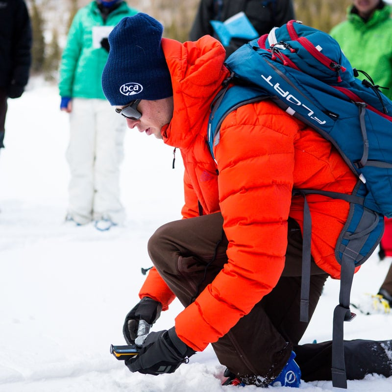 A student practices using and avalanche beacon on an AIARE Avalanche Rescue course near Denver, Colorado.
