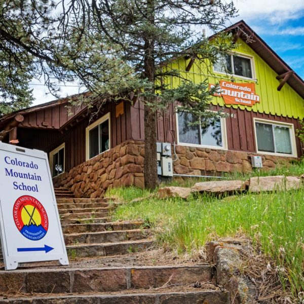 A stairway leads up to the Estes Park Adventure Hostel.