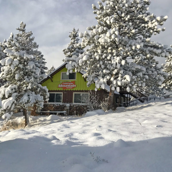 Estes Park Adventure Hostel on a snowy winter day.