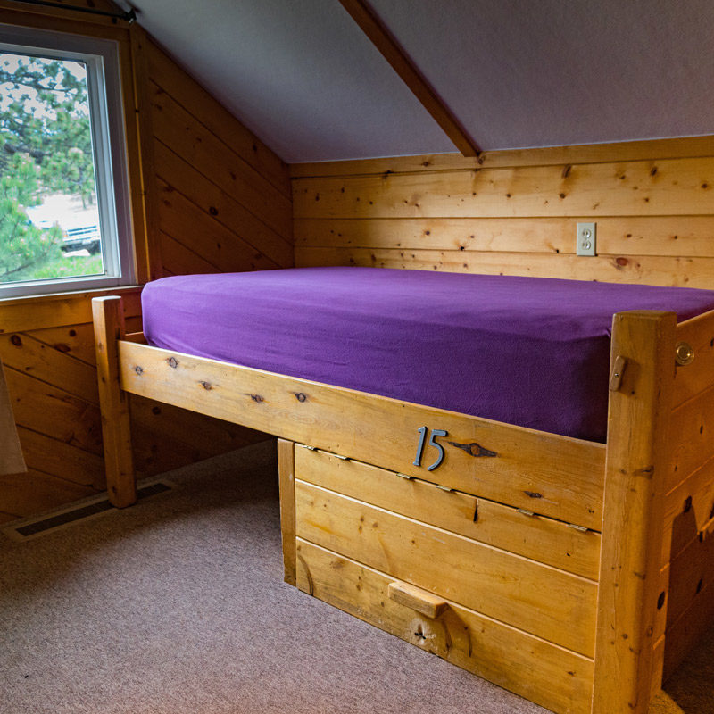 A bed and footlocker at the Estes Park Adventure Hostel