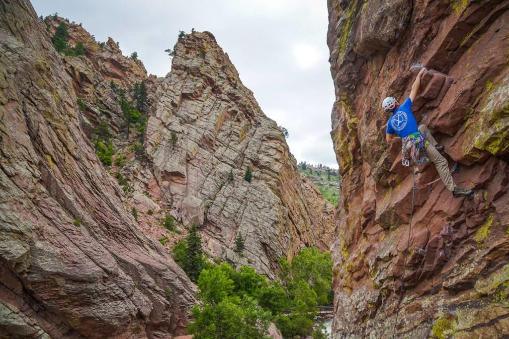IFMGA Certified Rock Guide Eric Whewell Climbing on the Bastile in Eldorado Canyon. Photo taken by IFMGA Guide Jayson Simons-Jones for Colorado Mountain School.