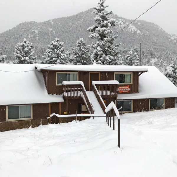 Estes Park Adventure Hostel under 6 inches of snow.