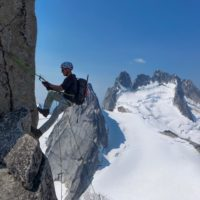 CMS Guide Mark Hammond Climbing in the RAB Merino + Hoody. Climbing in the Bugaboos in Canada.
