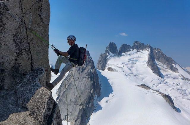 CMS Guide Mark Hammond Climbing in the RAB Merino + Hoody. Climbing in the Bugaboos in Canada.