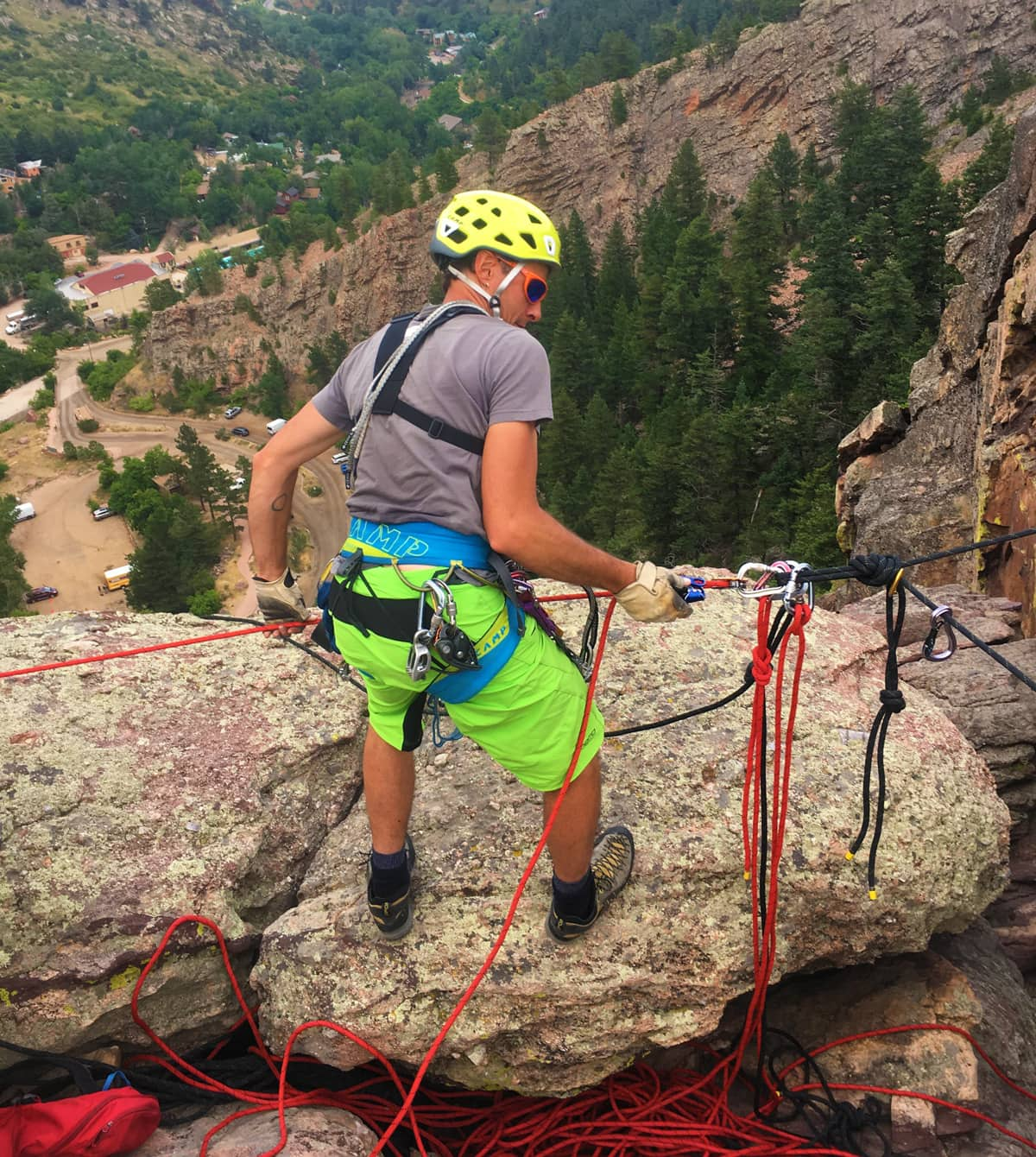 Internationally Certified Mountain Guide, Mike Lewis, rigging a technical rope system for a video production company in Eldorado Canyon - just outside of Denver, Colorado