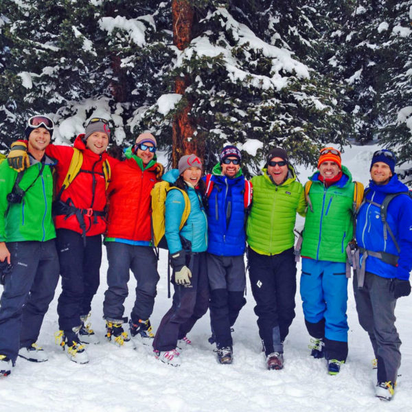A group of backcountry skiiers, with stoke high, after a day of skiing powder in the backcountry near Estes Park, Colorado.