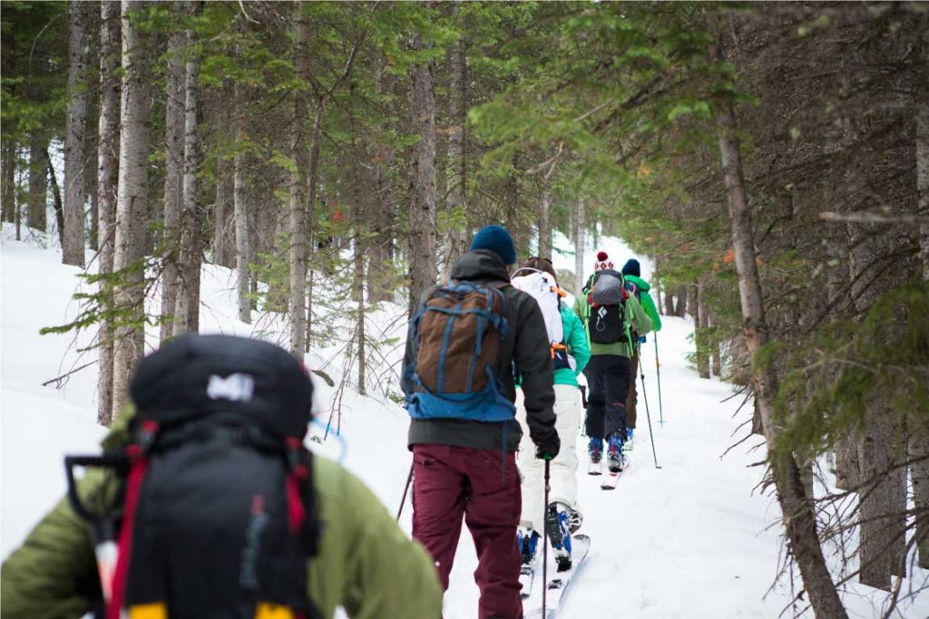 A group of friends tour on a snowy path in Rocky Mountain National Park