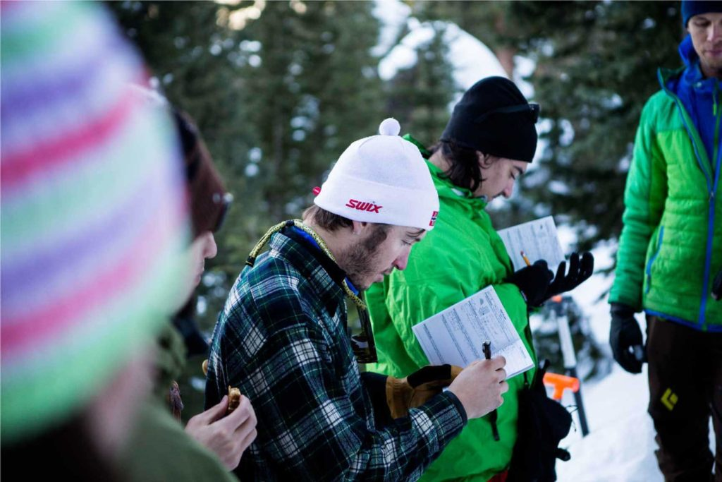 AIARE 1 avalanche training course participants record snow observations during their field days.