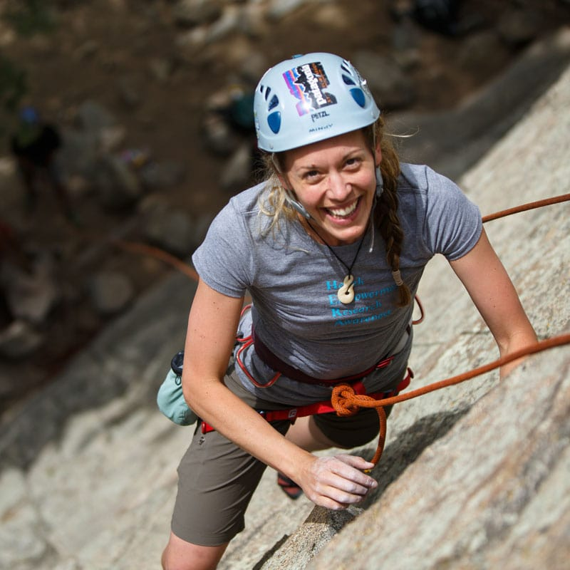 Woman rock climbing on a beginner climb near Boulder, Colorado