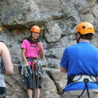 CMS guide Norie Kizaki teaching a rock climbing course with Colorado Mountain Scool
