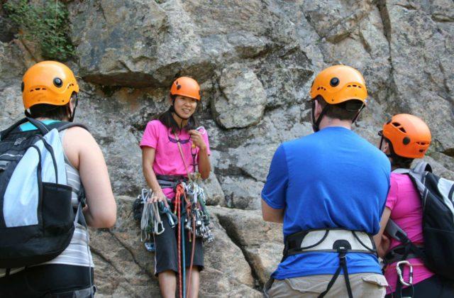 CMS guide Norie Kizaki teaching a rock climbing course with Colorado Mountain Scool