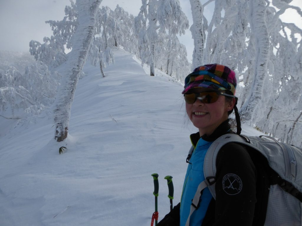 Colorado Mountain School guide Norie Kizaki ski guiding in Japan on a Colorado Mountain School international ski expedition.