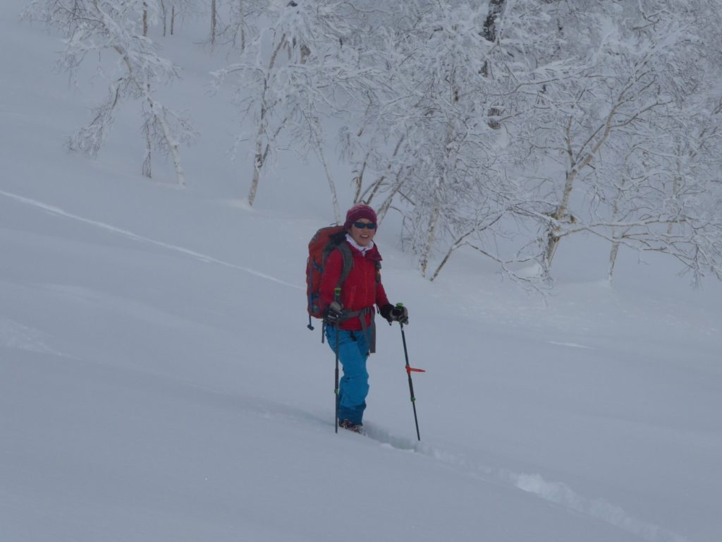 Colorado Mountain School guide Norie Kizaki skis powder in Japan while on a guided backcountry ski trip in Japan