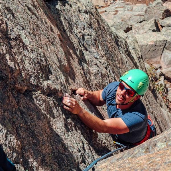 Rock climber ascends a pitch at a top-roping crag in Boulder Canyon Colorado