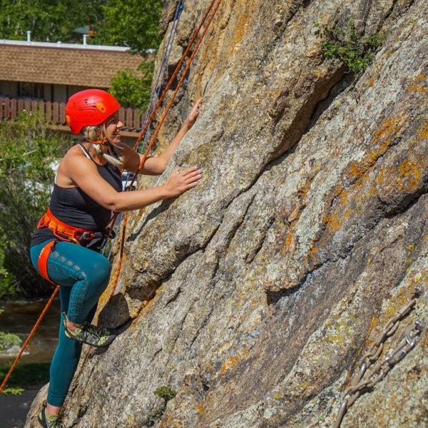 A climber ascends a rock climbing crag in Estes Park, Colorado.