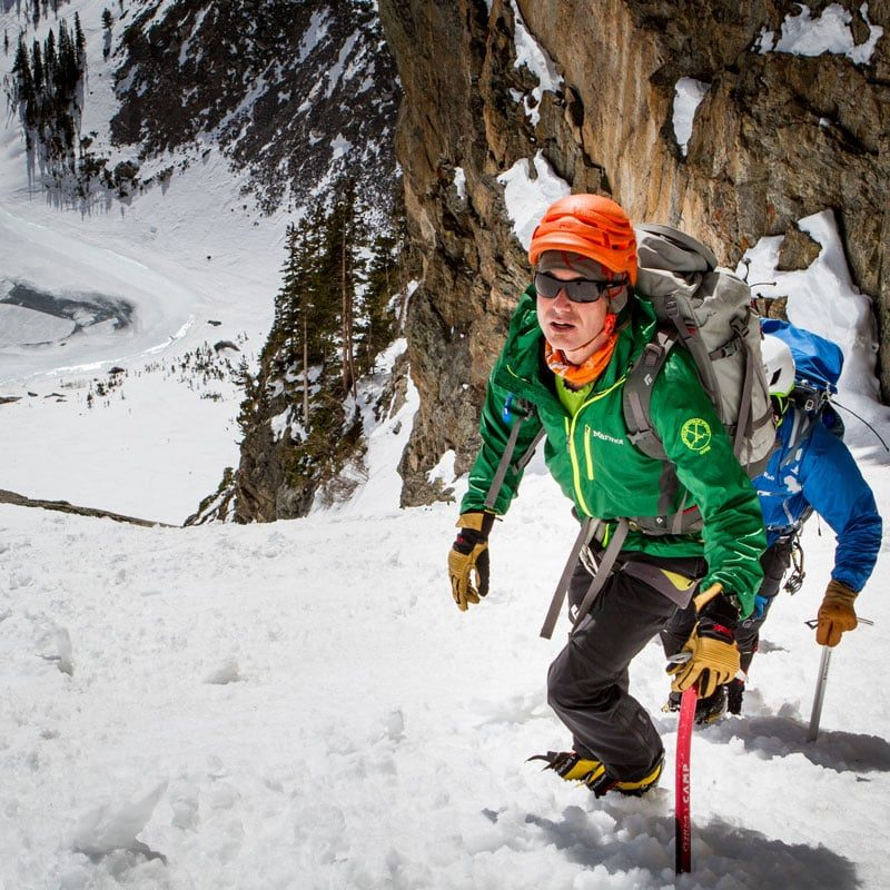 Colorado Mountain School Guide, Rainbow Weinstock, leads a mountaineering team up Dragontail Couloir in Rocky Mountain National Park.