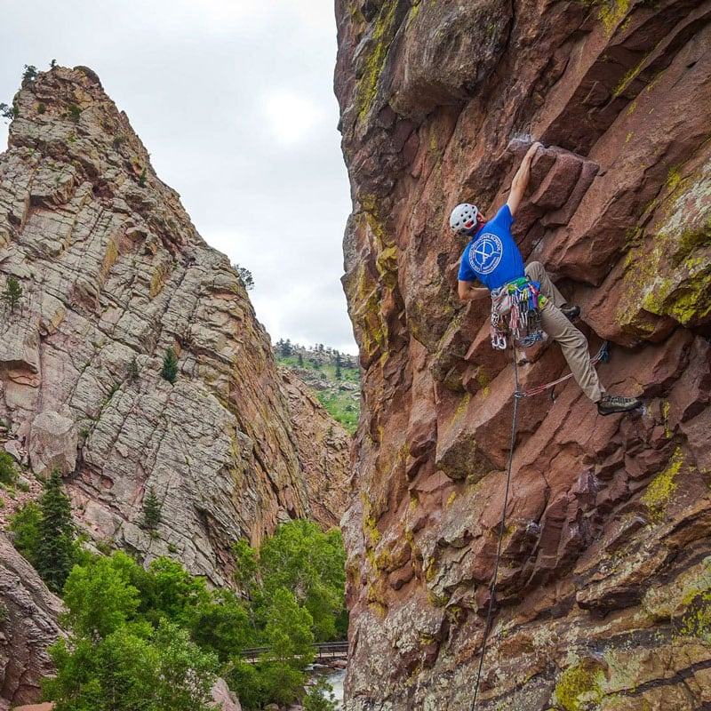 Colorado Mountain School Guide, Eric Whewell, leads a pitch high on The Bastille formation in Eldorado Canyon State Park, just outside of Boulder, Colorado