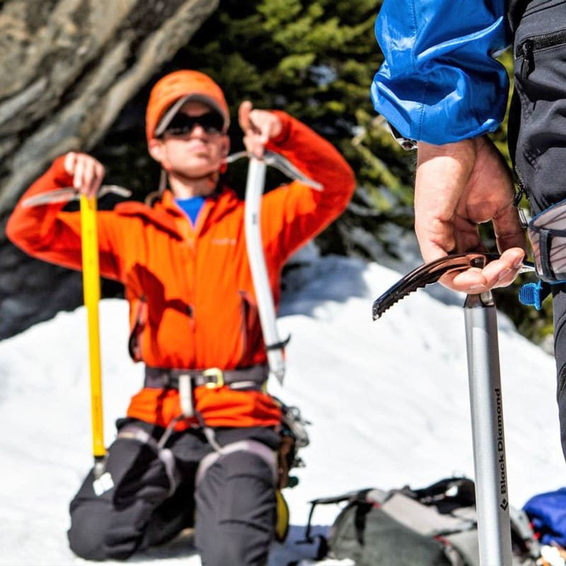 Colorado Mountain School Guide, Rainbow Weinstock, teaches a group of students about different mountain tools on an Into to Mountaineering course in Rocky Mountain National Park.