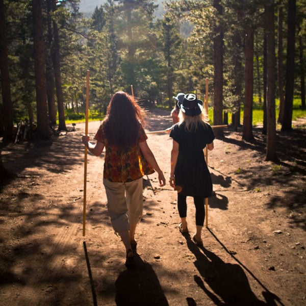 Two hikers take a hike down a trail at Dao House in Estes Park, Colorado.