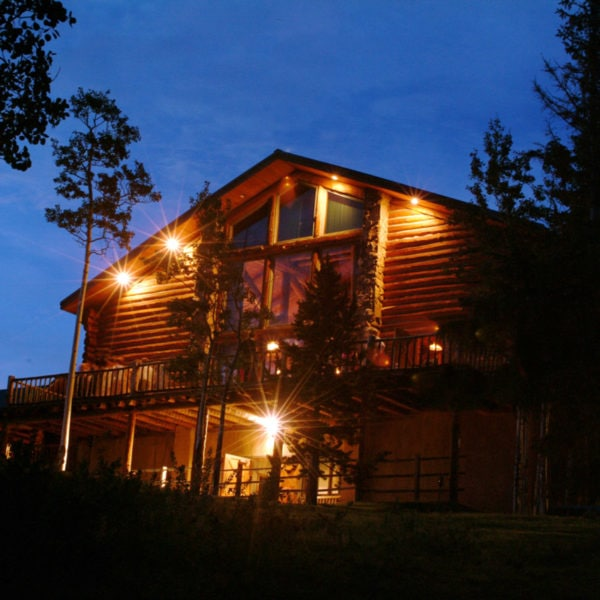 The lodge at Dao House is lit up under the night sky in Estes Park, Colorado.