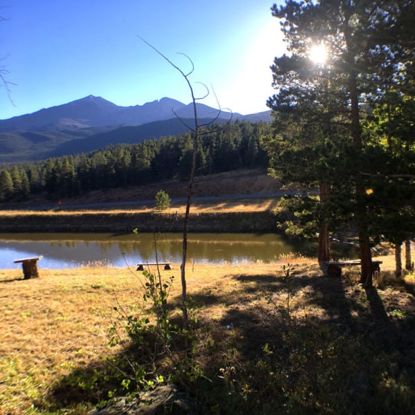 Longs Peak dominates the skyline over the lake at Dao House in Estes Park, Colorado.