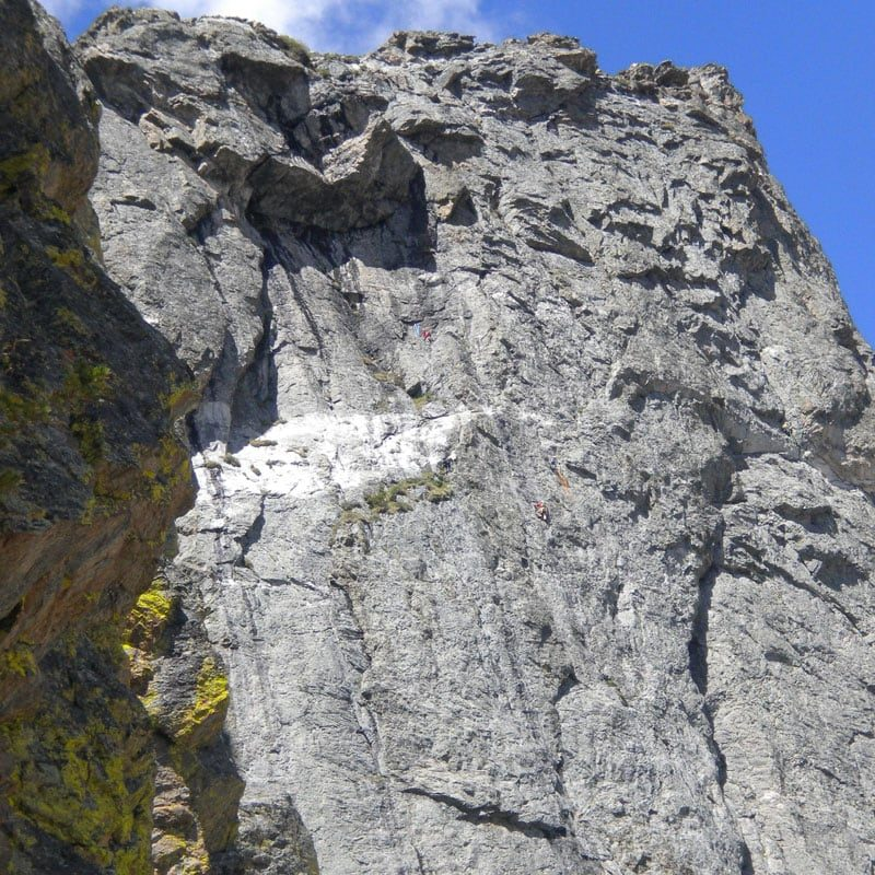 A pair of rock climbers near the roof on Love Route on Hallet Peak in Rocky Mountain National Park.