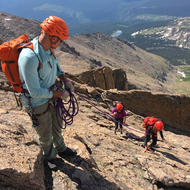 A guide leads a pair of climbers up the Keyhole Route on Longs Peak in Rocky Mountain National Park.