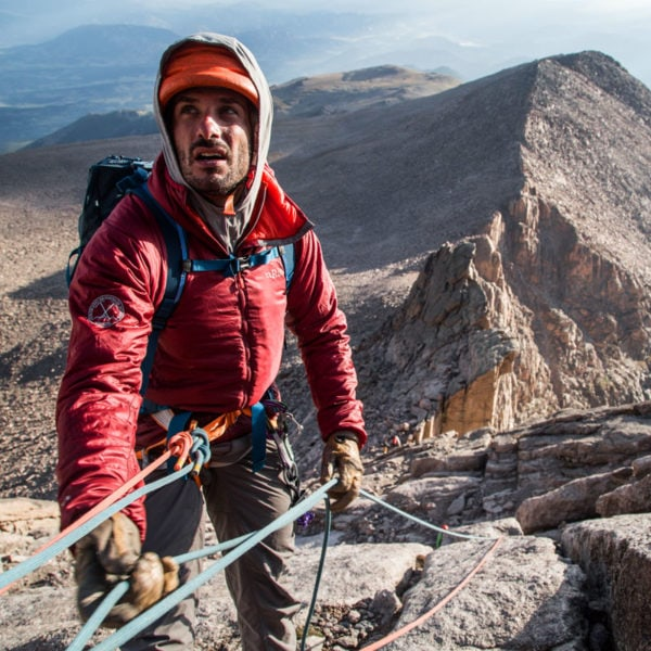 Mountain Guide, Max Lurie, belays a climber up the North Face of Longs Peak on a guided climb.