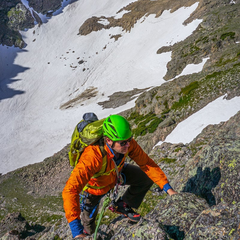 A mountaineer climbs Spiral Route on Notchtop Mountain in Rocky Mountain National Park.