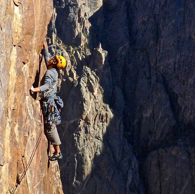 Colorado Mountain School Guide, Buster Jesik, leads a pitch in the Black Canyon of the Gunnison. Buster is an IFMGA / AMGA Certified Mountain Guide.