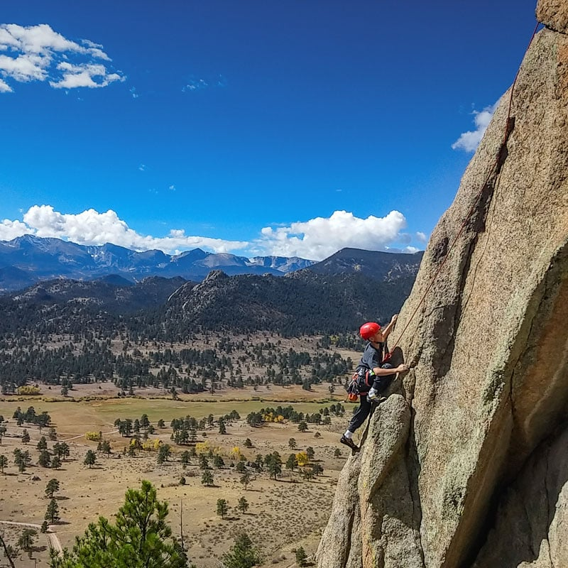A rock climbers ascends a rock face at Lumpy Ridge in Rocky Mountain National Park.