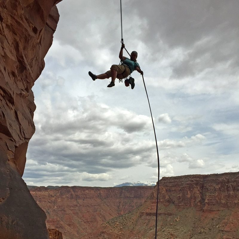 Colorado Mountain School client rappels from a desert tower. Colorado Mountain School is the premier rock climbing guide service in the Moab region.