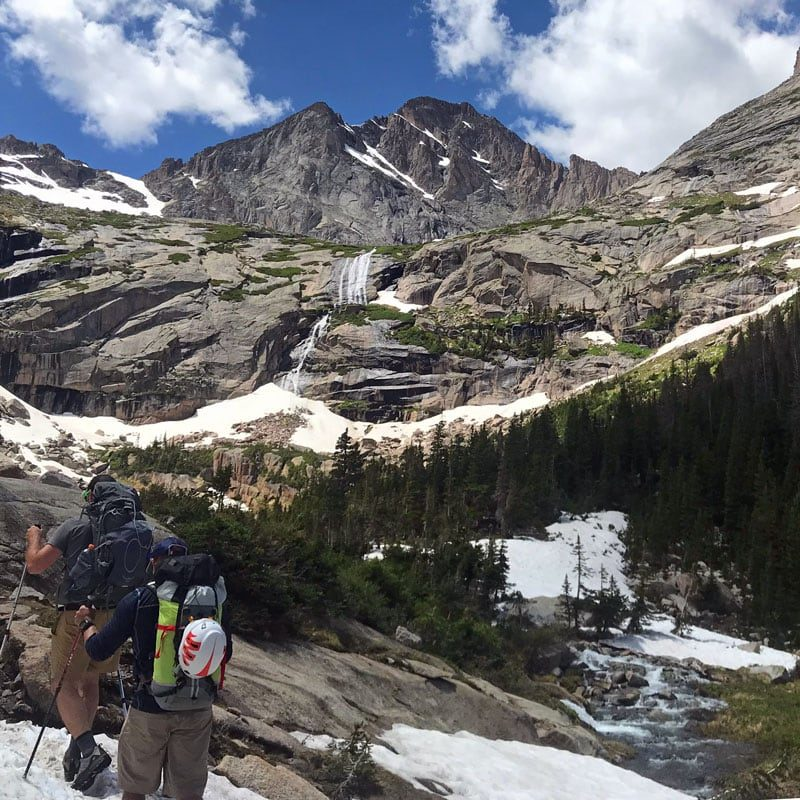 A pair of rock climbers approach Spearhead via the Glacier Gorge trail.