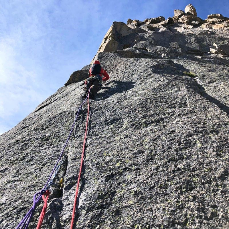A rock climber lead a pitch high on The North Ridge of Spearhead in Rocky Mountain National Park.