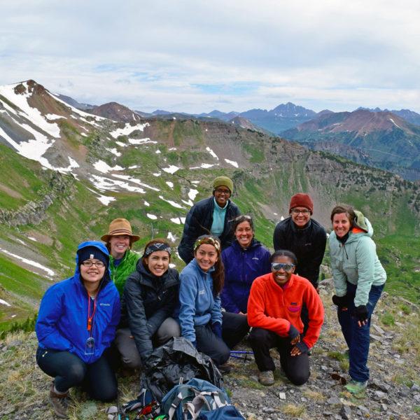 A team poses on the summit of a successful adventure fundraising climb near Denver, Colorado.