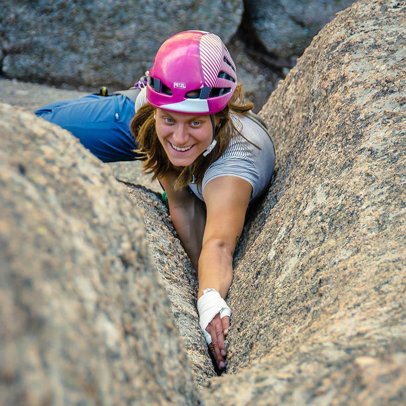 Colorado Mountain School Guide, Ally Bloom, leads a pitch while guiding a rock climbing trip in Vedauwoo, Wyoming.
