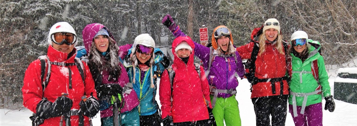 A group of women, arm in arm, after a great day of backcountry skiing in Rocky Mountain National Park.