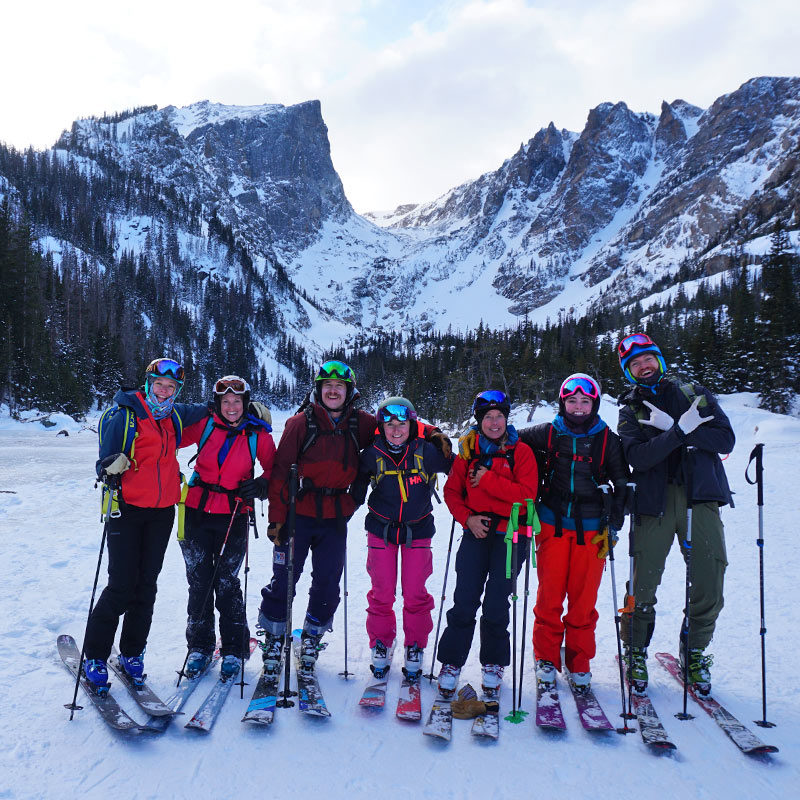 A group of backcountry skiiers finish up a day of ski touring in Rocky Mountain National Park. Colorado Mountain School guides custom adventure tours in the backcountry for groups and clubs.